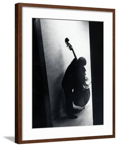 Young Bassist Member of Alexander Schneider's New York String Orchestra Tuning His Instrument-Gjon Mili-Framed Art Print