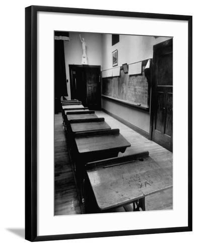 Looking Down Row of Empty Scarred Old Fashioned Desks in Schoolroom-Walter Sanders-Framed Art Print