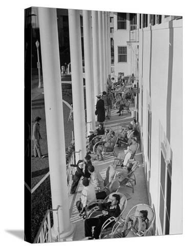 Porch-Sitting, One of Miamians Major Outdoor Sports, White House Hotel-Alfred Eisenstaedt-Stretched Canvas Print