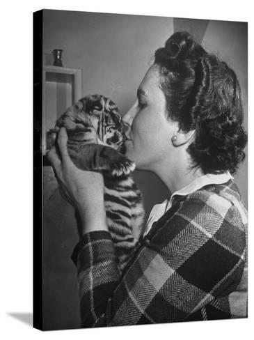 Mrs. Martini, Wife of the Bronx Zoo Lion Keeper, Kissing a Tiger Cub-Alfred Eisenstaedt-Stretched Canvas Print