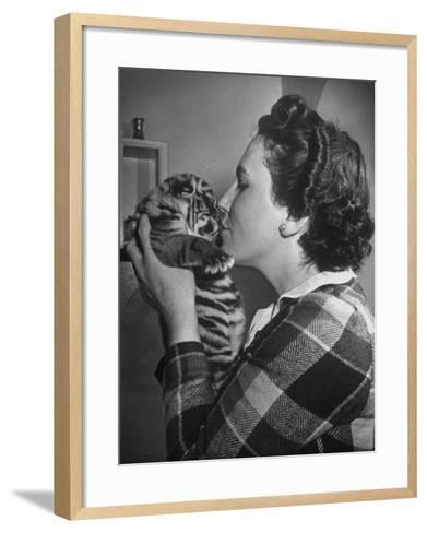 Mrs. Martini, Wife of the Bronx Zoo Lion Keeper, Kissing a Tiger Cub-Alfred Eisenstaedt-Framed Art Print