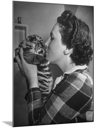 Mrs. Martini, Wife of the Bronx Zoo Lion Keeper, Kissing a Tiger Cub-Alfred Eisenstaedt-Mounted Photographic Print