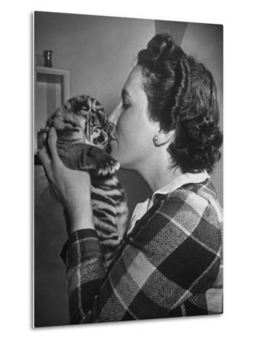 Mrs. Martini, Wife of the Bronx Zoo Lion Keeper, Kissing a Tiger Cub-Alfred Eisenstaedt-Metal Print