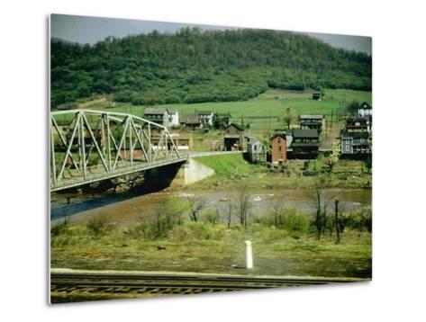 Small Motor Traffic Bridge over Stream Next to a Little Town-Walker Evans-Metal Print