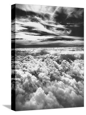 Thick, Dark Clouds Standing Still in the Sky-Fritz Goro-Stretched Canvas Print