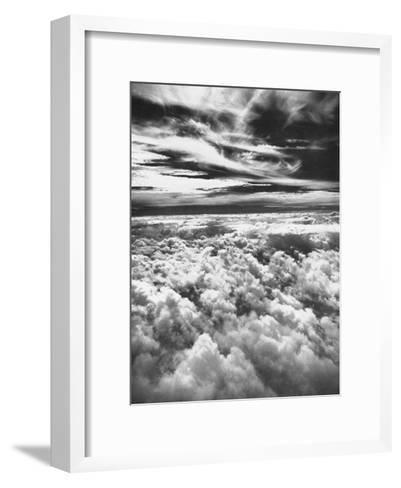 Thick, Dark Clouds Standing Still in the Sky-Fritz Goro-Framed Art Print