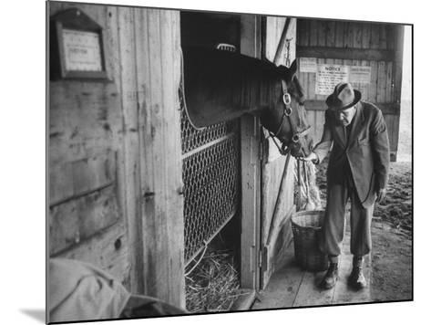 Trainer Jim Fitzsimons at Aqueduct Track Stables after William Woodward's Death in Stable-Grey Villet-Mounted Photographic Print