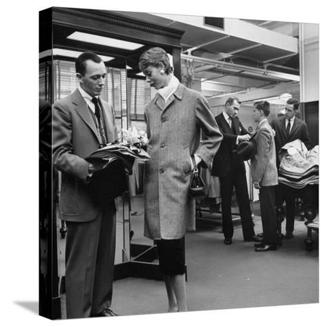Woman Shopping in Brooks Brothers Wearing Men's Tweed Topcoat-Nina Leen-Stretched Canvas Print