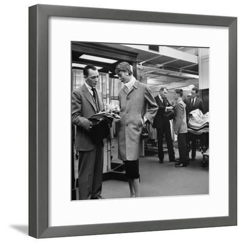 Woman Shopping in Brooks Brothers Wearing Men's Tweed Topcoat-Nina Leen-Framed Art Print