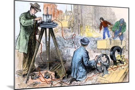 Workers Testing the Insulation of Electric Wires Going in the Streets of New York City, 1882--Mounted Giclee Print
