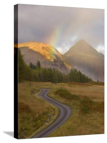 Mountain Road with Rainbow in Glen Etive, Argyll, Scotland, UK, October 2007-Niall Benvie-Stretched Canvas Print
