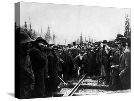 Unident. Man Driving in Last Spike of Canadian Pacific Railroad--Stretched Canvas Print