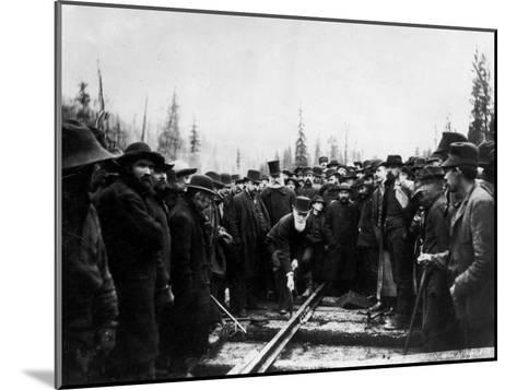 Unident. Man Driving in Last Spike of Canadian Pacific Railroad--Mounted Photographic Print