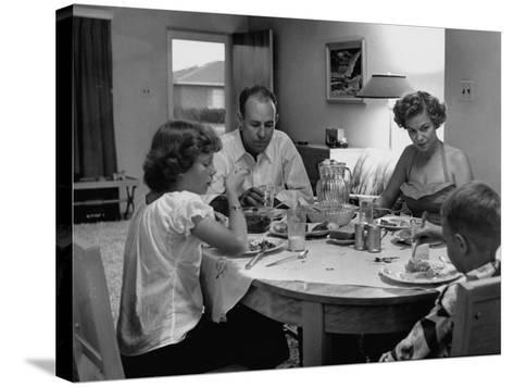 Arizona Family Seated at their Dining Room Table, Enjoying their Dinner-Nina Leen-Stretched Canvas Print