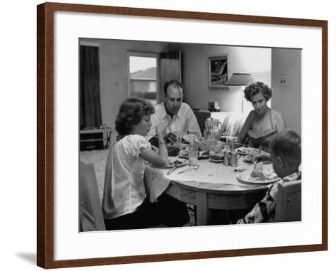 Arizona Family Seated at their Dining Room Table, Enjoying their Dinner-Nina Leen-Framed Art Print