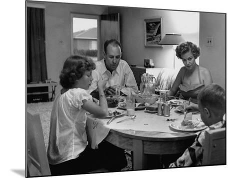 Arizona Family Seated at their Dining Room Table, Enjoying their Dinner-Nina Leen-Mounted Photographic Print