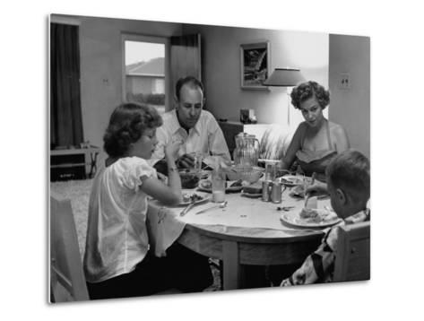 Arizona Family Seated at their Dining Room Table, Enjoying their Dinner-Nina Leen-Metal Print