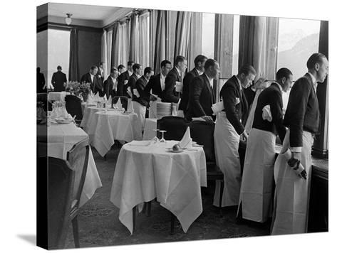 Waiters at the Grand Hotel Line Up at the Windows to Watch Sonja Henie Ice Skate Outside-Alfred Eisenstaedt-Stretched Canvas Print