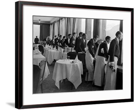 Waiters at the Grand Hotel Line Up at the Windows to Watch Sonja Henie Ice Skate Outside-Alfred Eisenstaedt-Framed Art Print