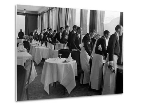 Waiters at the Grand Hotel Line Up at the Windows to Watch Sonja Henie Ice Skate Outside-Alfred Eisenstaedt-Metal Print