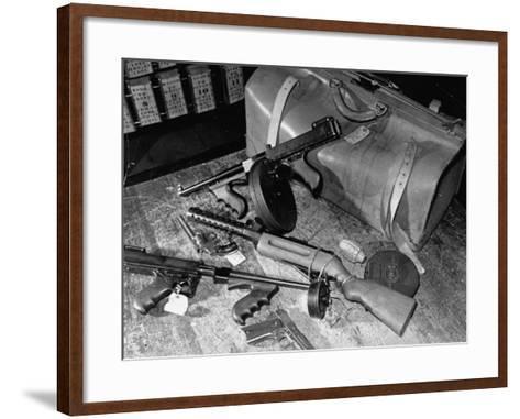 Arsenal of Machine Guns, Pistols, Shotguns Etc.- Belongs to Recently Captured Frank Dailey and Gang-Carl Mydans-Framed Art Print
