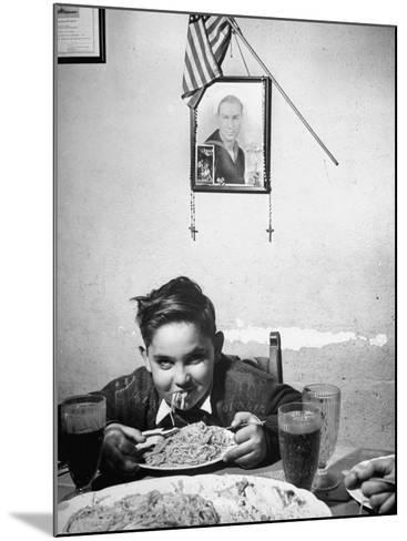 Boy Eating Spaghetti under Picture of His Brother Who Died During Invasion of Sicily--Mounted Photographic Print