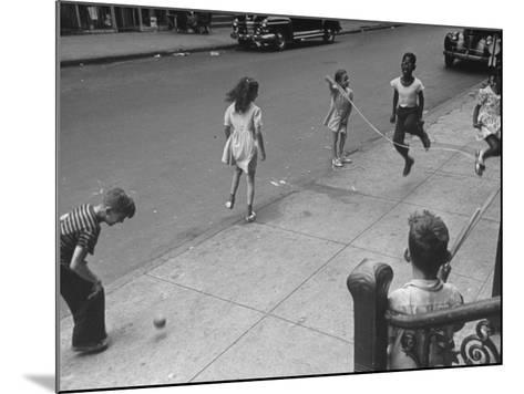 Children Jumping Rope on Sidewalk-Ed Clark-Mounted Photographic Print