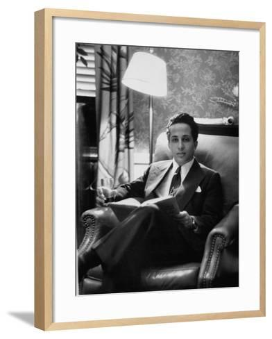 Iraq's King Feisal II Relaxing Reading a Book-Yale Joel-Framed Art Print