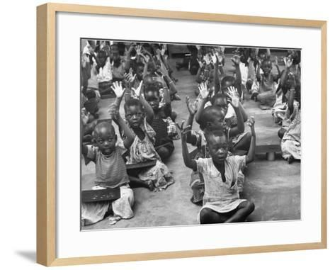 Children Raising their Hands in the Air During Kipuchi Kindergarten Classes-Dmitri Kessel-Framed Art Print