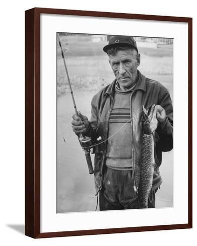 Fisherman Lauri Rapala, Who Handmakes Fishing Lures, with a Fish He Caught--Framed Art Print