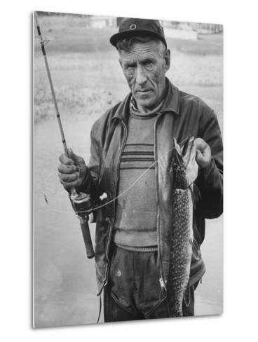 Fisherman Lauri Rapala, Who Handmakes Fishing Lures, with a Fish He Caught--Metal Print