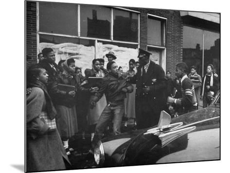Police Breaking Up a Fight in the Slums--Mounted Photographic Print
