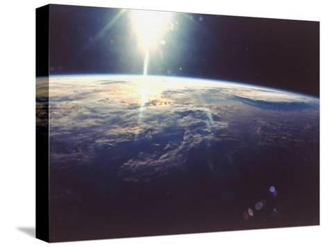 Sunlight over Earth Taken from Space Shuttle Discovery VIII Mission--Stretched Canvas Print