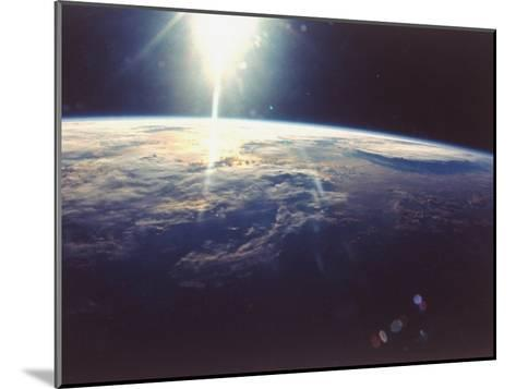 Sunlight over Earth Taken from Space Shuttle Discovery VIII Mission--Mounted Photographic Print