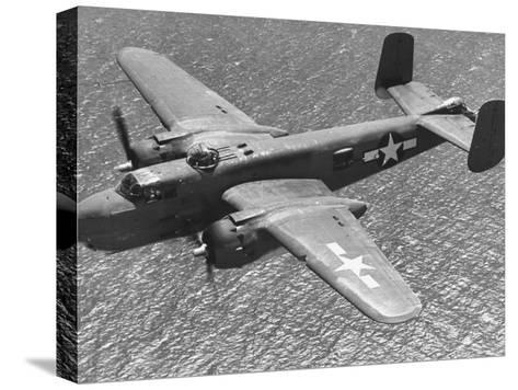 Excellent of a B-25 Mitchell Bomber in Flight--Stretched Canvas Print