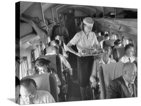 Eastern Airline Travelers Receiving a Mid-Flight Meal from a Female Steward--Stretched Canvas Print