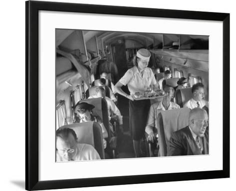 Eastern Airline Travelers Receiving a Mid-Flight Meal from a Female Steward--Framed Art Print