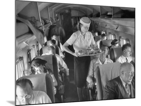 Eastern Airline Travelers Receiving a Mid-Flight Meal from a Female Steward--Mounted Photographic Print