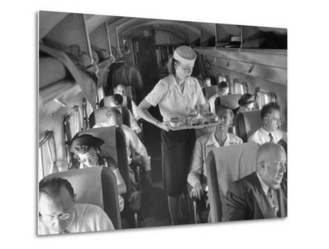 Eastern Airline Travelers Receiving a Mid-Flight Meal from a Female Steward--Metal Print