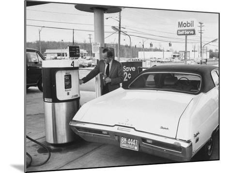 Motorist Filling Up His Own Car at a Self Service Gas Station-Ralph Morse-Mounted Photographic Print