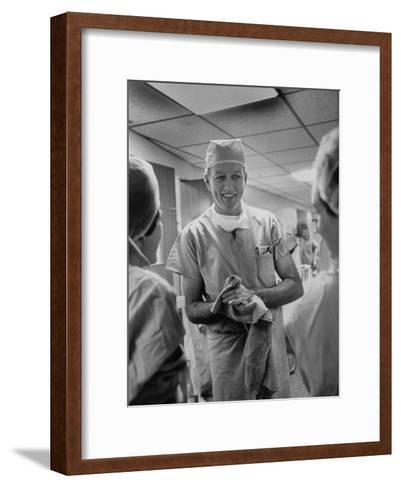 Dr. Denton A. Cooley, Chief Heart Surgeon at the St. Luke's Episcopal Hospital-Ralph Morse-Framed Art Print