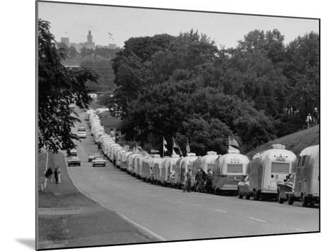 Long Line of Airstream Trailers Wait for Parking Space at a Campground During a Trailer Rally-Ralph Crane-Mounted Photographic Print