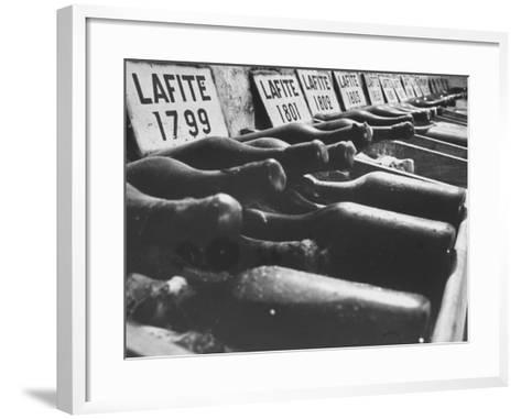 Bottles of Lafite Wines, Now Museum Pieces in French Wine Cellar-Carlo Bavagnoli-Framed Art Print