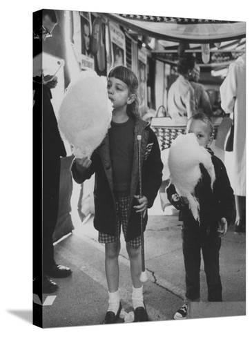 Children Eating Cotton Candy Given by a League of Women Voters-Ralph Crane-Stretched Canvas Print
