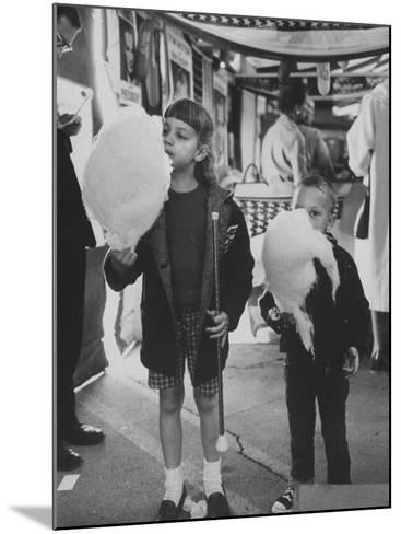 Children Eating Cotton Candy Given by a League of Women Voters-Ralph Crane-Mounted Photographic Print