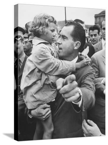 US Vice-President Richard M. Nixon Holding a Little Polish Girl--Stretched Canvas Print