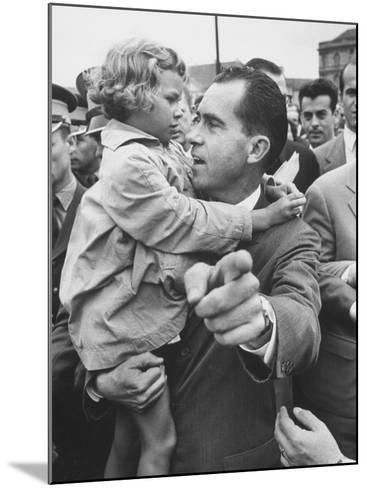 US Vice-President Richard M. Nixon Holding a Little Polish Girl--Mounted Photographic Print