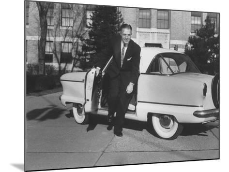 President of American Motors George W. Romney Getting Out of His Car-Grey Villet-Mounted Photographic Print