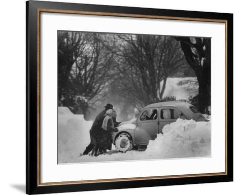 People Trying to Push a Snowbound Car--Framed Art Print