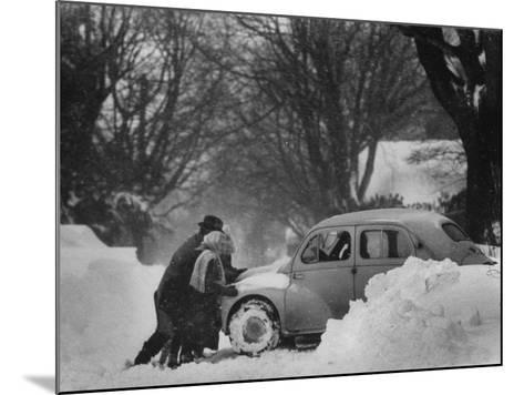 People Trying to Push a Snowbound Car--Mounted Photographic Print